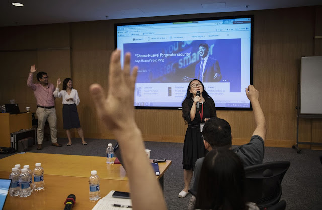 """Huawei workers from the Public Affairs and Communications department take part in a training session at """"Huawei University"""" at the company's Bantian campus"""
