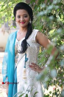 Tamil Actress Koushika Stills in White Salwar Kameez at Inayathalam Tamil Movie Audio Launch  0007.jpg