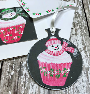 Hand painted snowman topped cupcake Christmas card design painted on to a card and mount board bauble shape that can be used as a gift tag