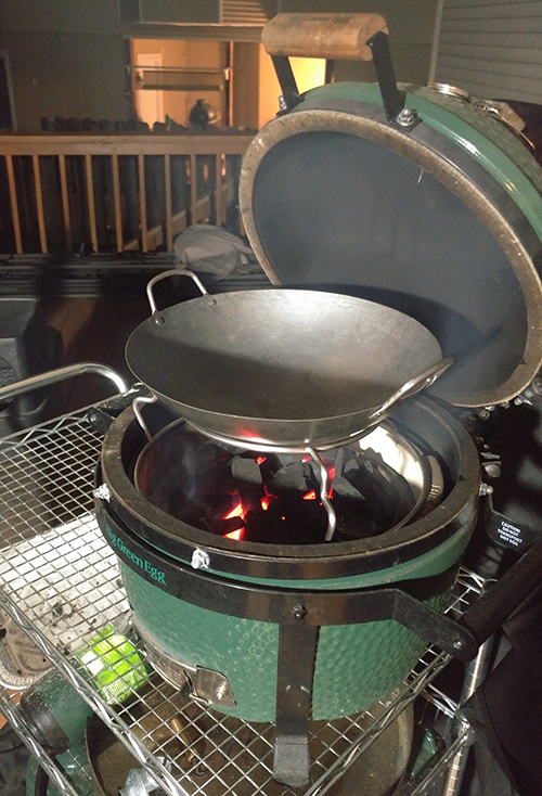 Carbon steel wok for kamado grills from the Ceramic Grill Store on a Big Green Egg Mini-Max