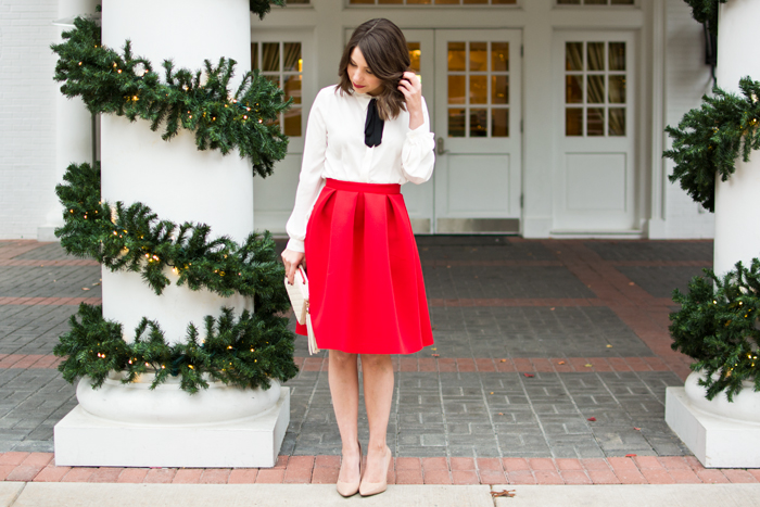 christmas eve outfit idea, holiday party look, outfit ideas, red midi skirt, midi skirt, pussybow blouse, nude heels, midi skirt, fashion blogger christmas