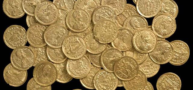 Monedas romanas y adjudicacion en Derecho romano