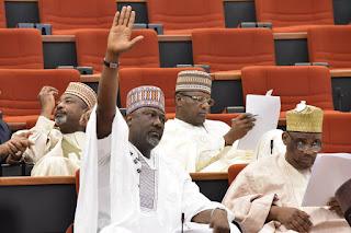 Dino-Melaye-raises-hand-in-senate house for motion