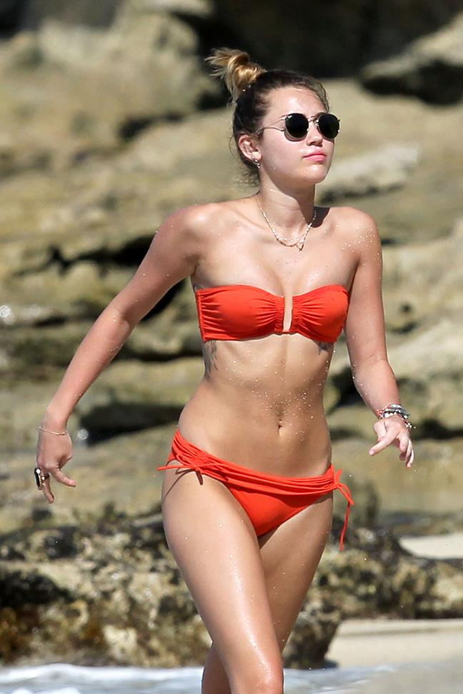 Miley Cyrus Orange Bikini
