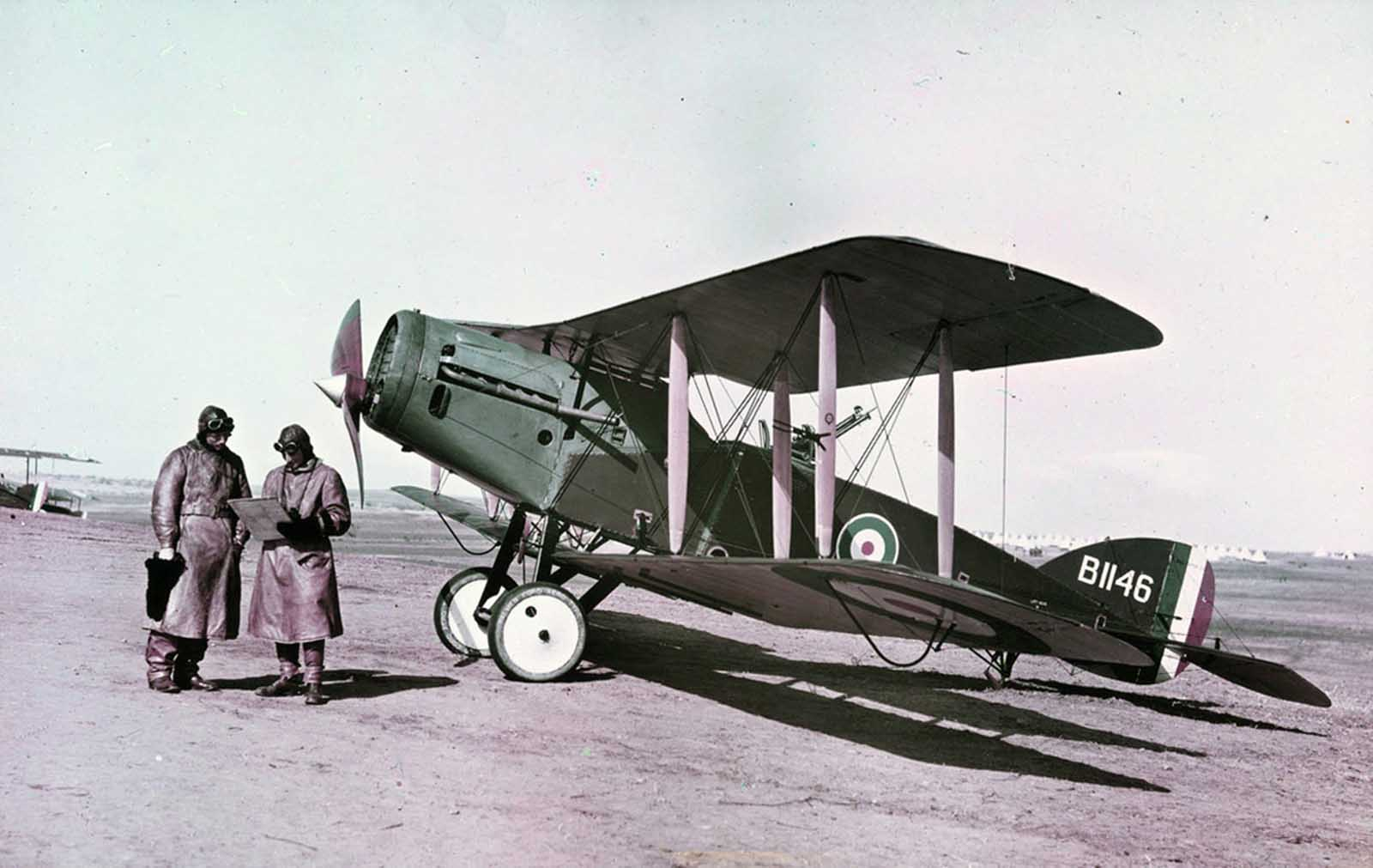 Captain Ross-Smith (left) and Observer in front of a Modern Bristol Fighter, 1st Squadron A.F.C. Palestine, February 1918. This image was taken using the Paget process, an early experiment in color photography.