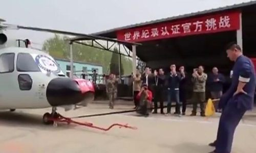 Kung Fu expert breaks World Record for hauling Helicopter with his manhood (Photos/Video) Inbox x