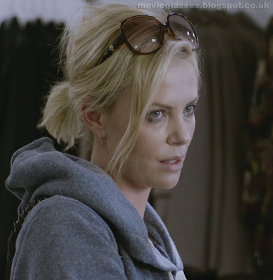 Charlize Theron in Young Adult wearing Dior Sunglasses while shopping for new clothes