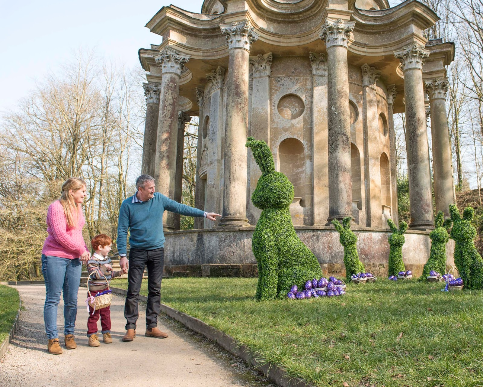 A family on the National Trust Easter Egg Hunt in partnership with Cadbury's