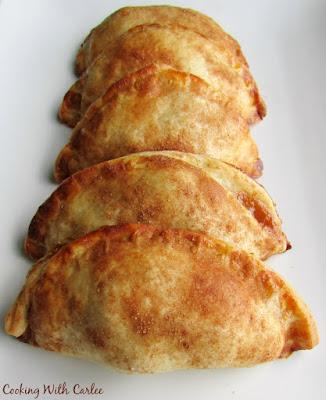 row of cajeta and apple empanadas on plate
