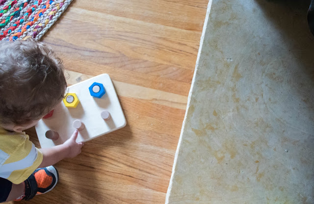 4 Montessori friendly tips to help your toddler learn to clean up after themselves.