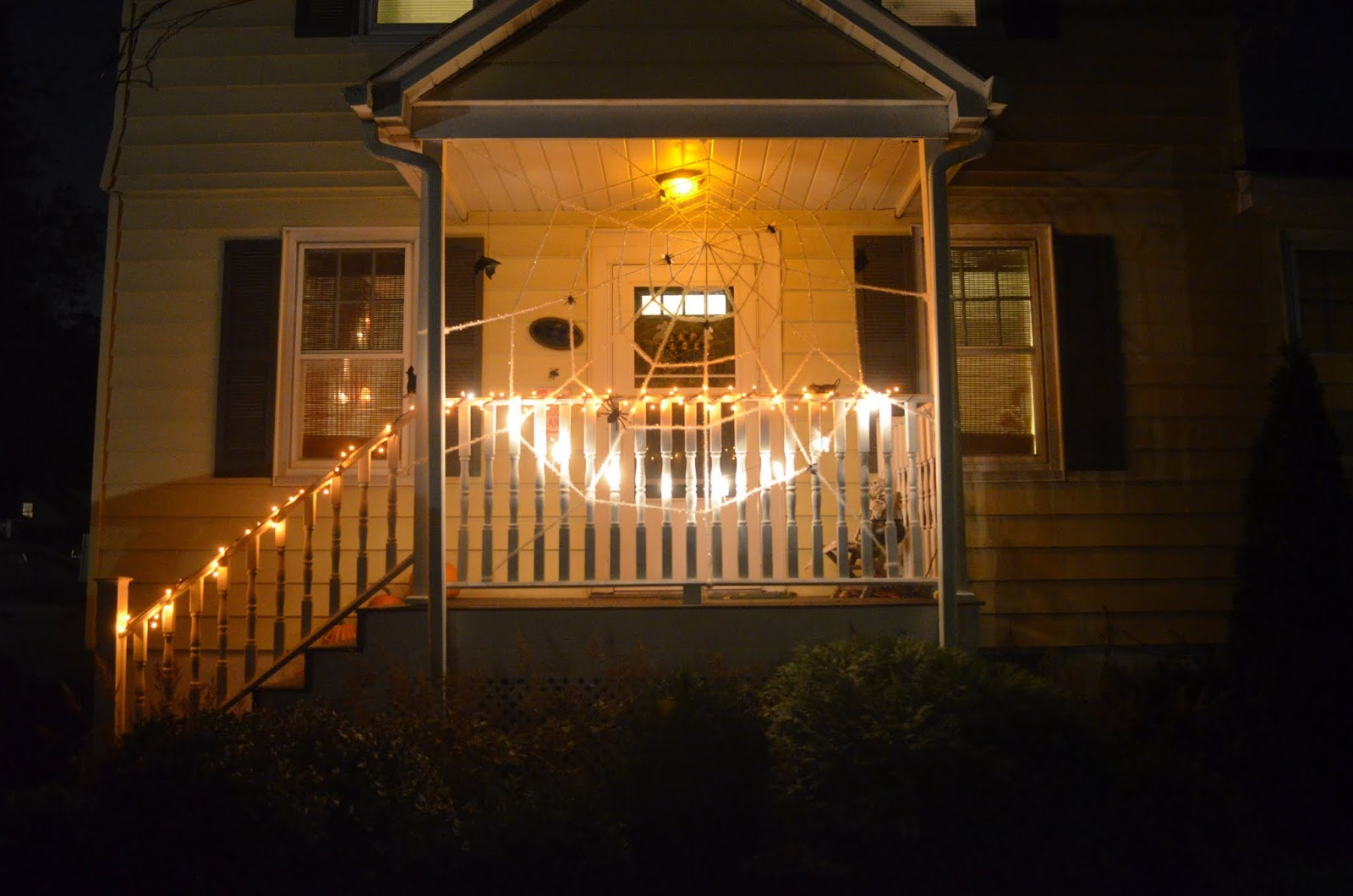 up by an orange bulb in our porch light a new small strand of orange halloween lights wrapped on the railing and the set of flashing skeleton lights
