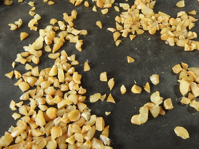 Garlic pieces being cooked in the oven