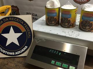 Africanos são presos com cocaína em latas de feijoada em aeroporto de SP