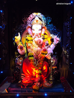 Huge Ganesh idol brightly lit up in a Mumbai suburban Ganpati pandal