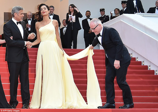 Amal Clooney struggles with thigh split gown at the Cannes Film Festival 2016