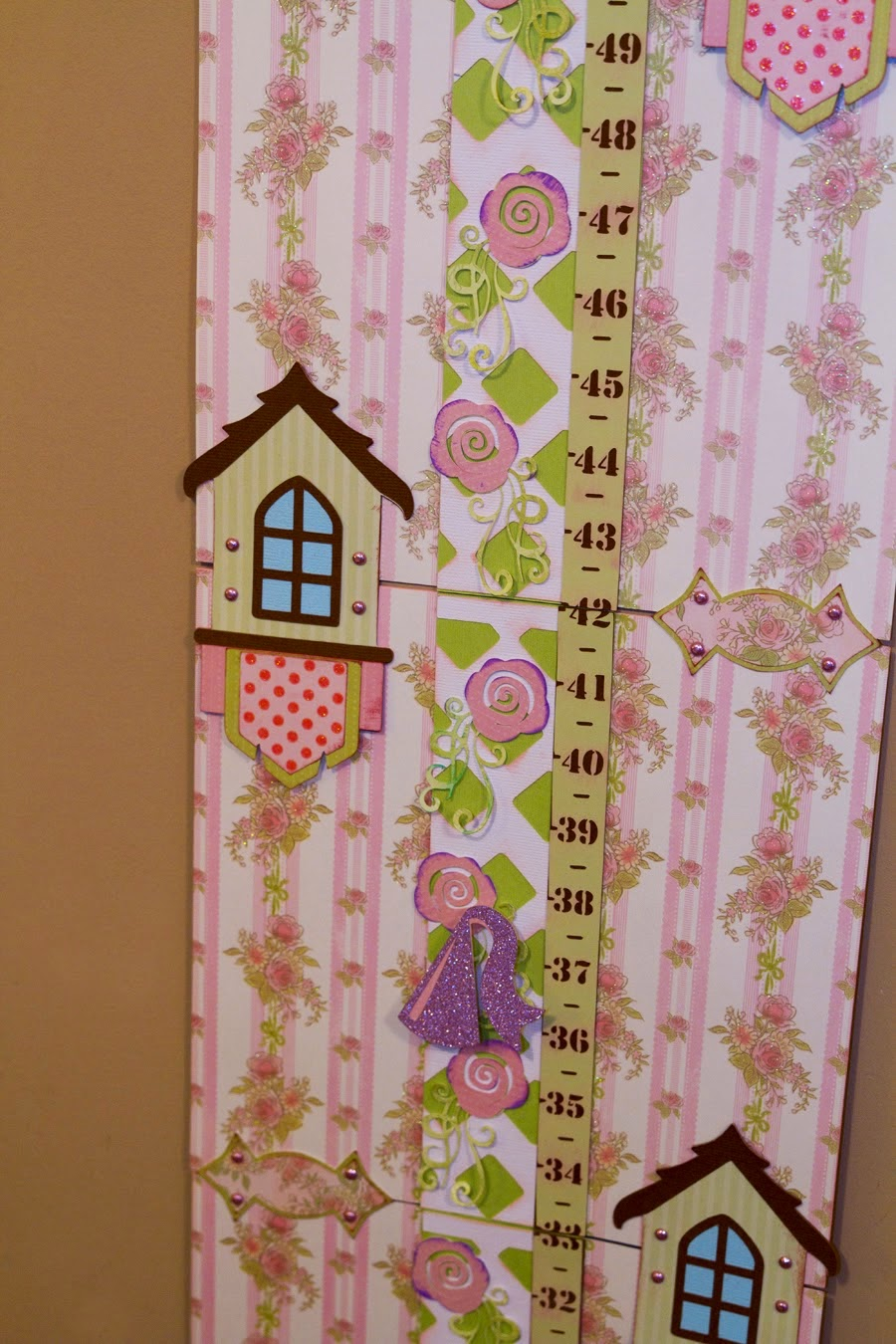 another view of the rose vine ruler showing princess hat as the height marker