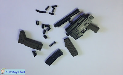 Assembling miniature toy gun that shoot