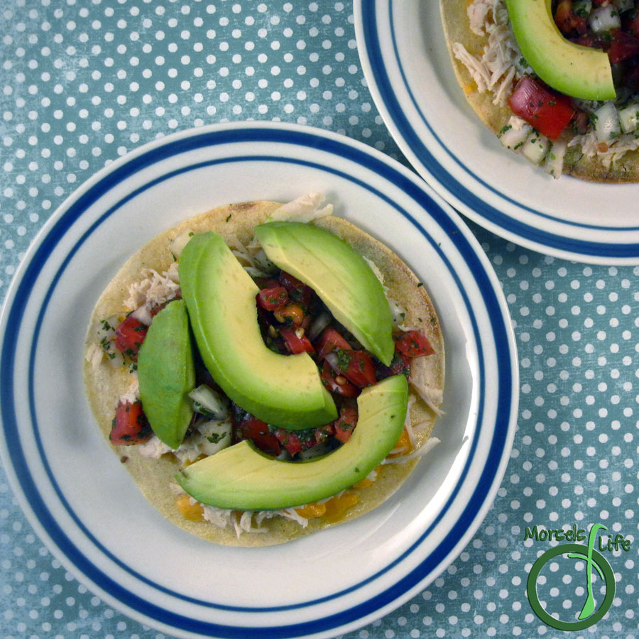 Morsels of Life - Chicken Tostadas - Try these chicken tostadas - avocado and salsa on top of a crispy, crunchy tostada layered with cheesy goodness.