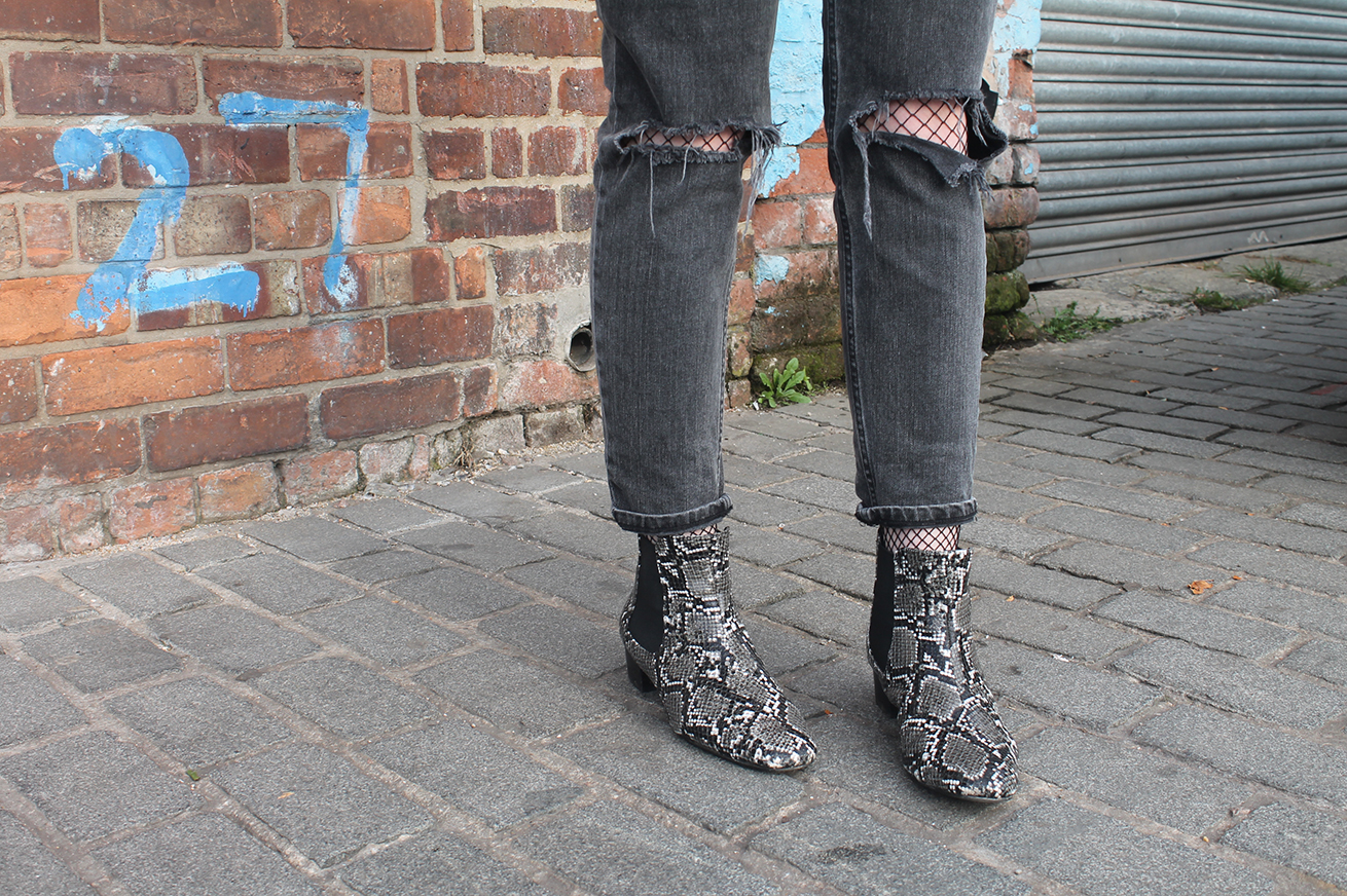 ripped jeans over fishnets, ASOS snake boots