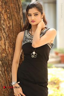 Actress Poojitha Pallavi Naidu Stills in Black Short Dress at Inkenti Nuvve Cheppu Movie Platinum Disc Function  0054.JPG