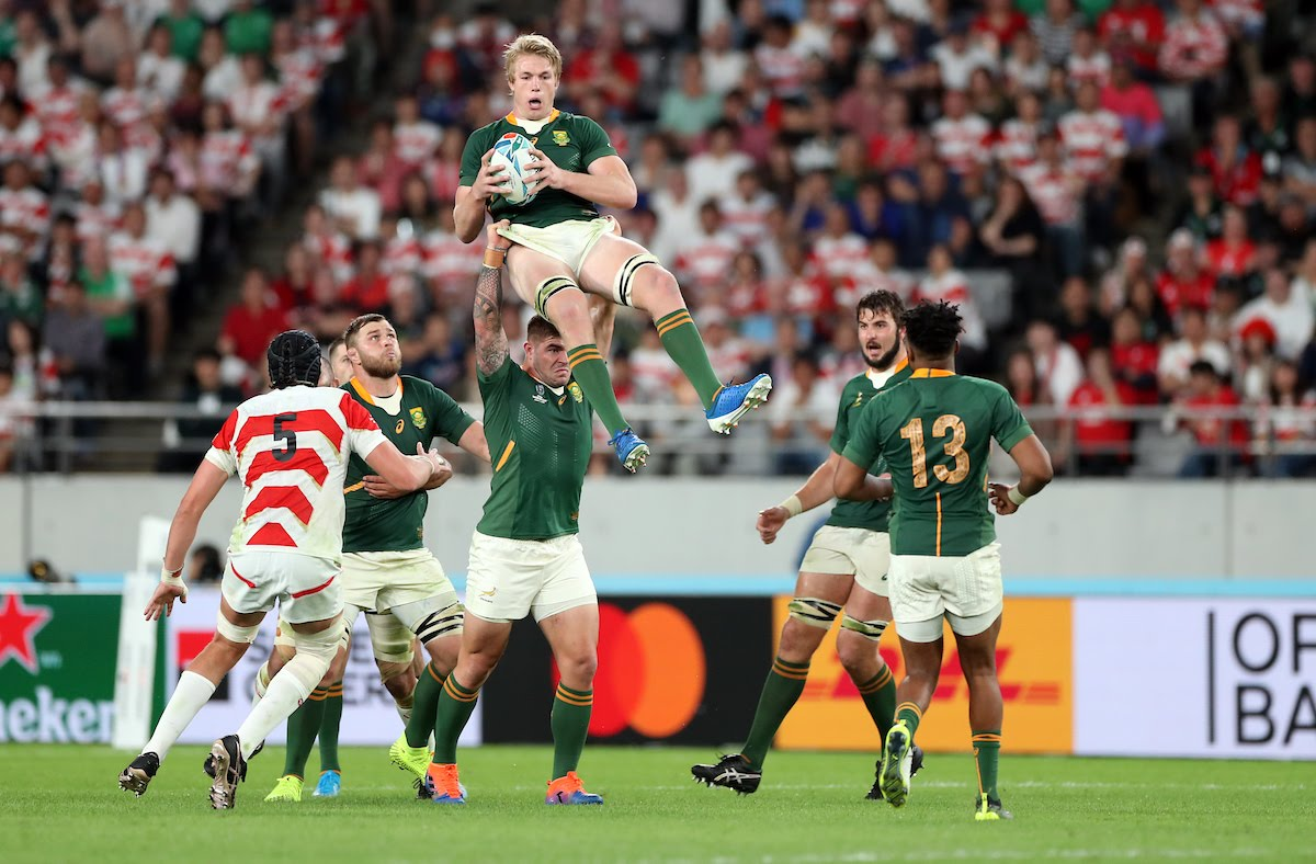 Malcolm Marx of South Africa holds up Pieter-Steph Du Toit of South Africa during the Japan and South Africa Springbok Quarter-Final at the