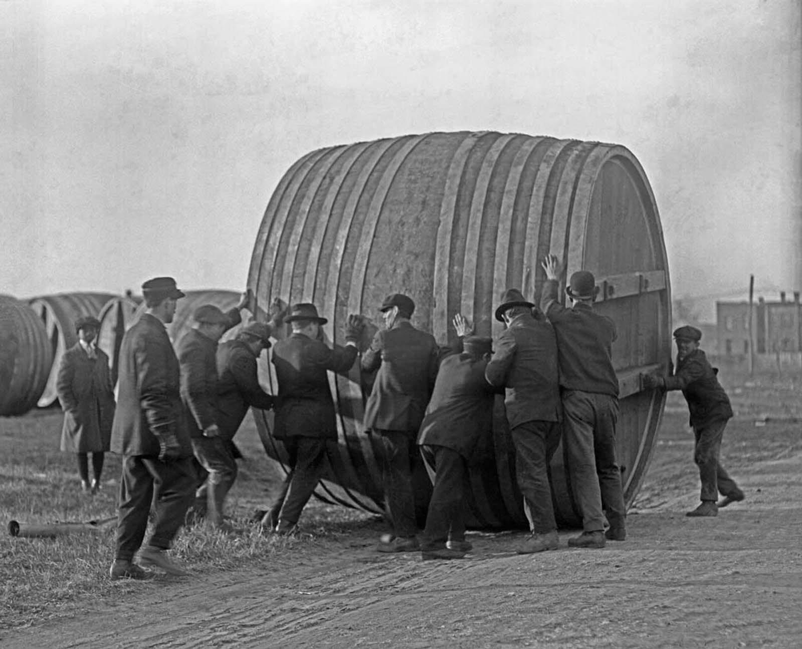 A brewery in Washington, DC, switches from brewing beer to making ice cream during Prohibition. Workers roll the giant beer vats out to make room for ice cream production equipment.