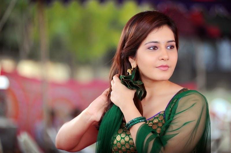 Bollywood Actress Rashi Khanna Cute Stills From Telugu Movie Joru In Green Dress