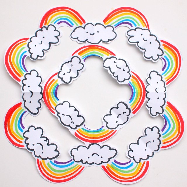cut rainbow snowflakes- a fun and colorful kirigami-esque craft for all rainbo