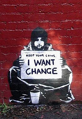 STREET ART: 'Keep Your Coins. I Want Change' by Banksy