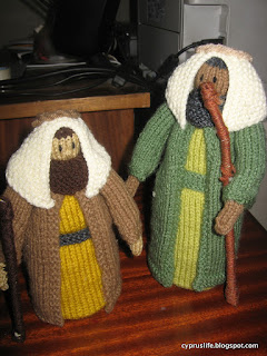 two shepherds from the knitted nativity, one rather shorter than the other