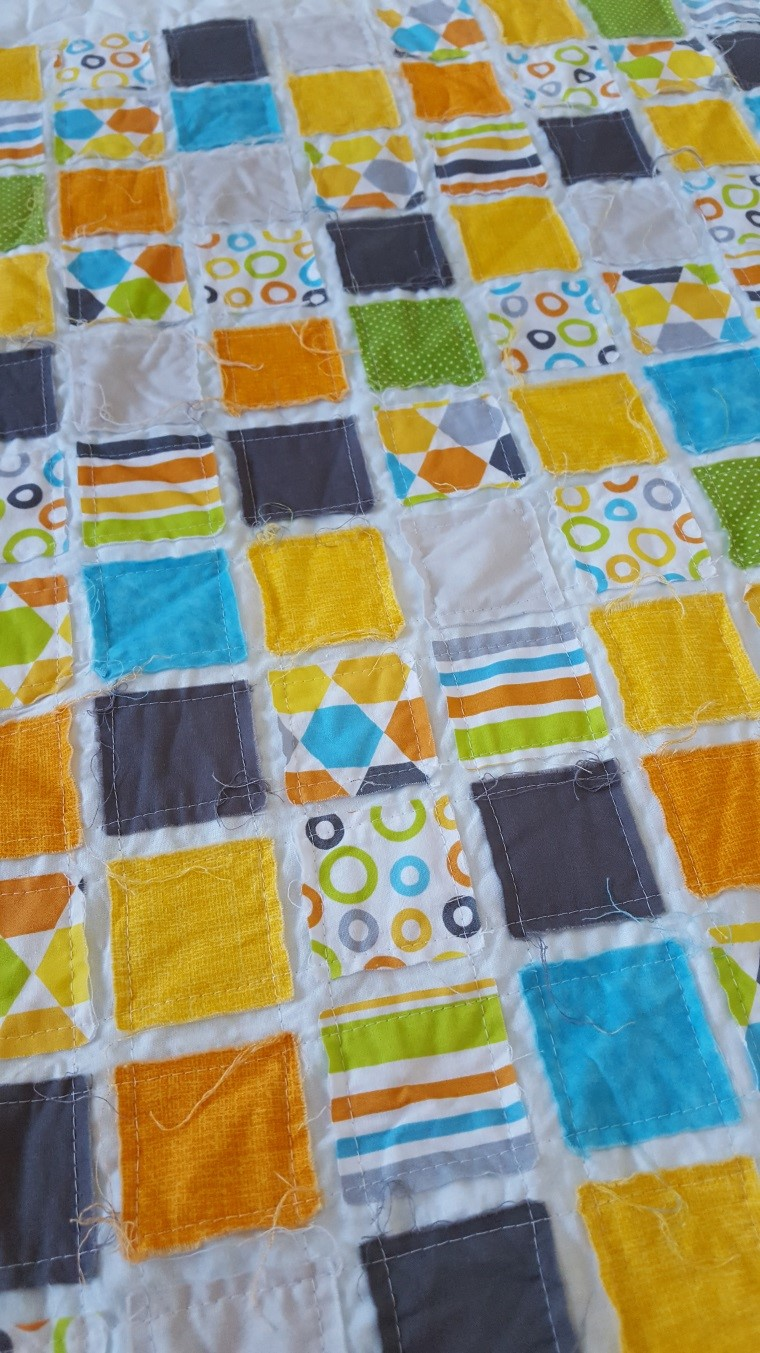 baby quilt for the beginner quilter using easy squares