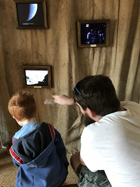 Father and son watching apollo launches on 4 small screens
