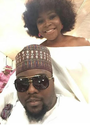 Omawumi and her husband pictured at a wedding