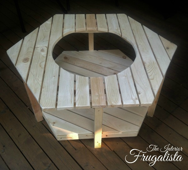 A budget-friendly DIY Adirondack Fire Bowl Coffee Table for a patio or deck with a unique hexagon pallet style for those cool summer evenings outdoors.