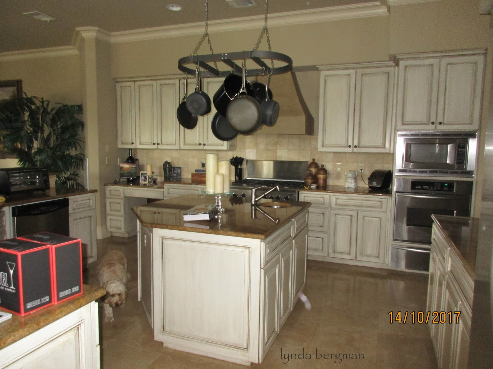 Lynda Bergman Decorative Artisan Painting Darkly Stained Kitchen Cabinets To An Off White Glazed Finish For Tracy Nick