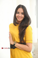Actress Poojitha Stills in Yellow Short Dress at Darshakudu Movie Teaser Launch .COM 0081.JPG