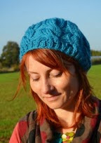 http://www.letsknit.co.uk/free-knitting-patterns/LK73-wool-week-slouchy-cable-beanie