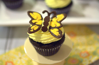 A close up of a dark chocolate butterfly cupcake