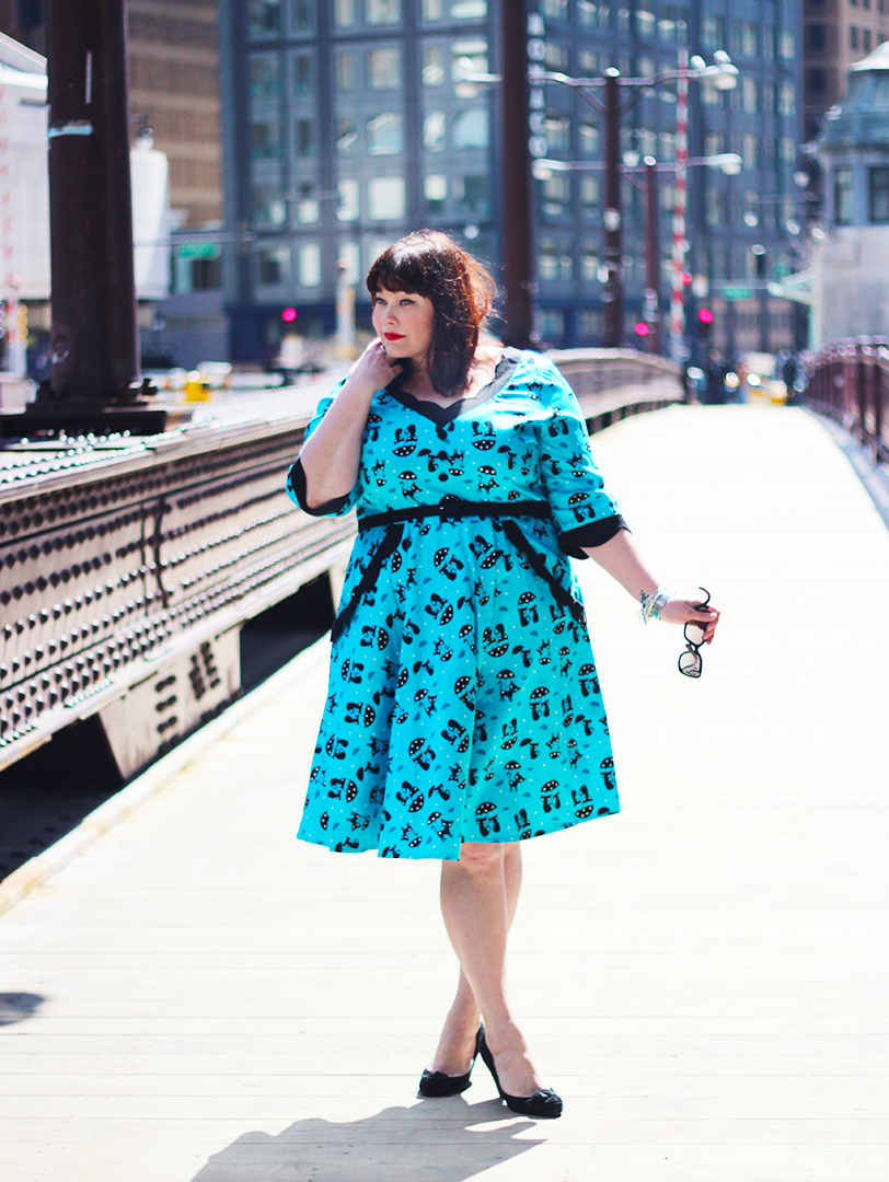 Plus Size Model Amber in a Blue Dress with Cats and Umbrellas