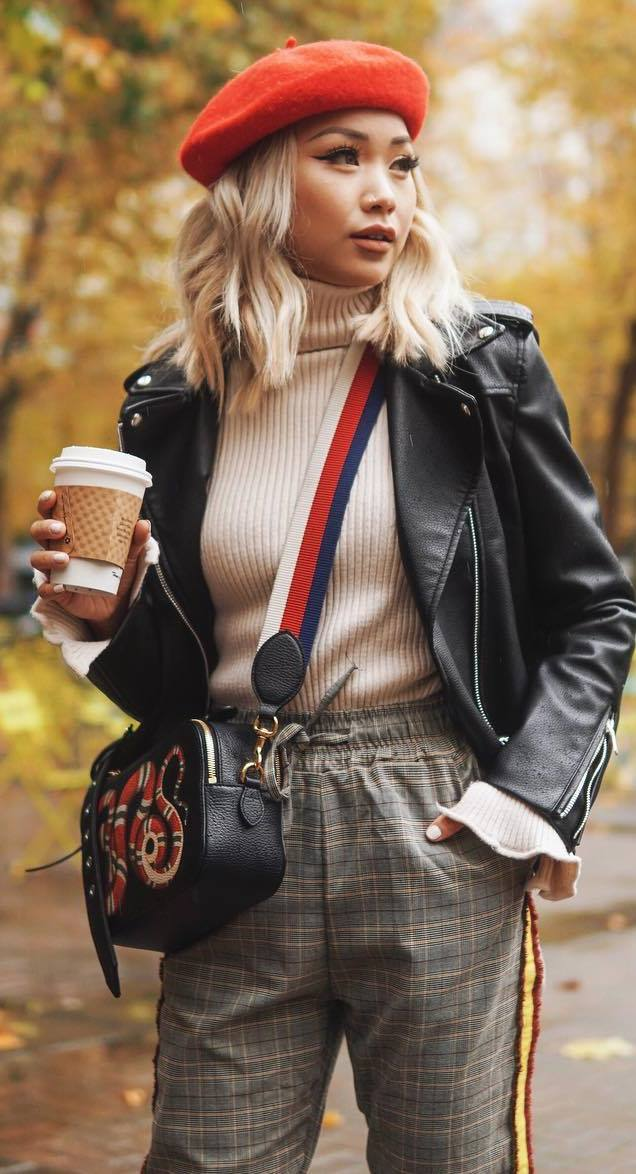 what to wear with a biker jacket : red hat + top + embroidered bag + pants