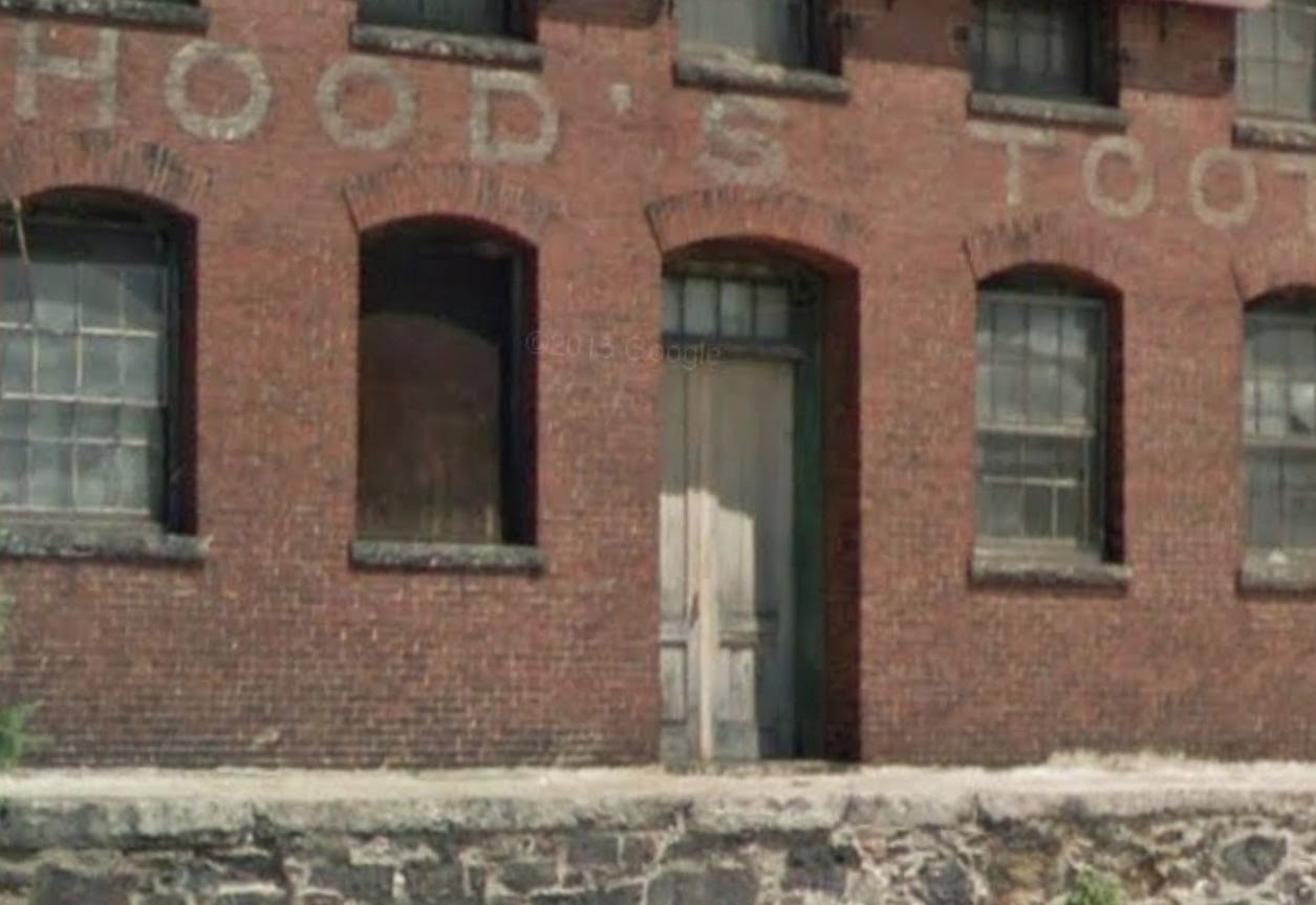 Google street view captures old white lettering on brick exterior of Hood's factory, Lowell MA