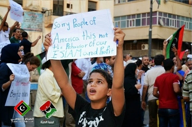 25 Photos Of People Who Will Inspire You - This photo at a Libyan peace rally apologizing for terrorism to Americans.