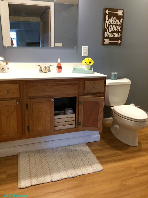 See how we took an ugly basement and turned it into a bright and cozy retreat along with adding laundry, bathroom, and mudroom spaces! Learn money saving tips and tricks from a DIYer.