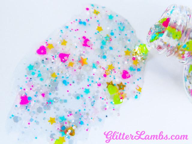 "Glitter Lambs ""Summer Smoothie"" Glitter Nail Polish is a custom handmade glitter topper nail polish made for doing some awesome summer nails! Summer Smoothie nail polish has gold holographic hearts, gold holographic stars, neon green hearts, neon hot pink hearts, mini pink stars, mini blue stars, mini yellow stars, and more! Glitter Lambs Nail Polish www.GlitterLambs.com Glitter Nails Glitter Nail Polishes for Sale"
