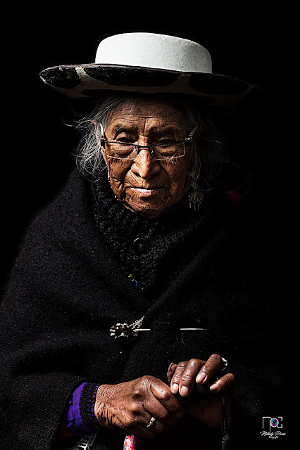 Native Saraguro woman sewing an item to sell in the market Loja Ecuador Photo