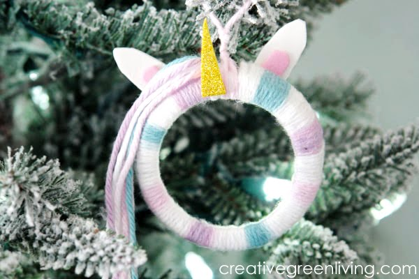 DIY Unicorn Ornament made with yarn and mason jar lid ring