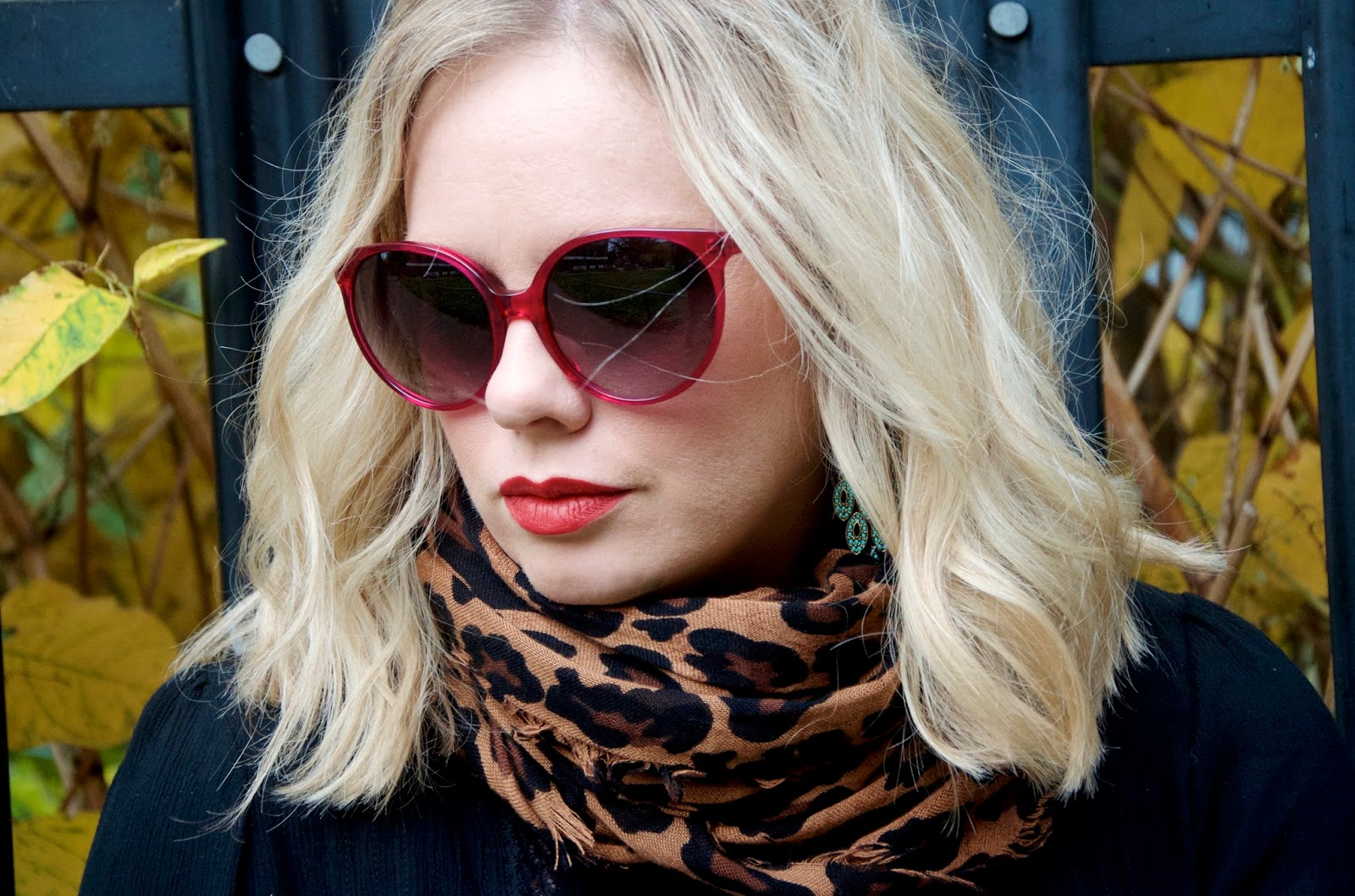 Turquoise earrings, leopard scarf, red lipstick, cerise sunglasses