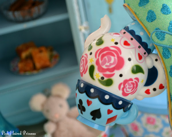 teapot and teacup heel on shoe in tea party setting