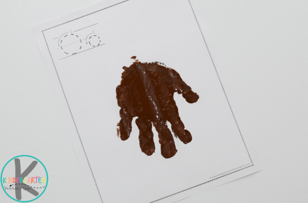 press brown handprint on paper