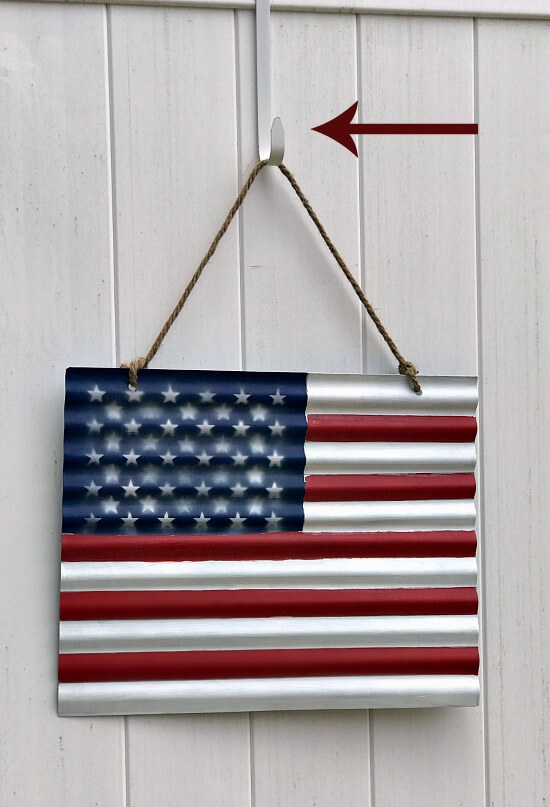 Fence hangers and a corrugated flag